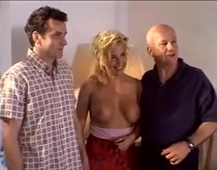 Sexy blonde milf gets two black dicks in front of hubby